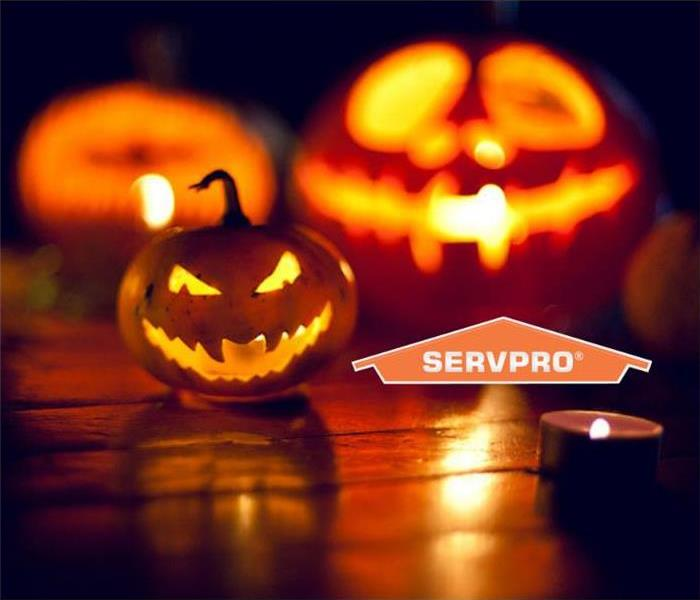SERVPRO pumpkins lit with battery operated candles.